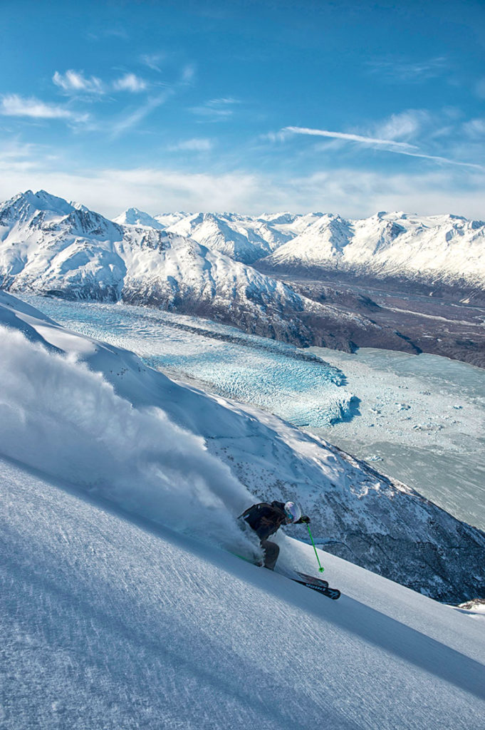 Heli-skiing is a drug minus the nasty side effects. Scratch that. The jones for something that makes you feel good, but doesn't destroy you is more powerful than drugs—if you can afford it. Valdez, Haines, and Girdwood are the biggest spots, but only at Alyeska—Chugach Powder Guides (CPG) operates from the base—do you have a ski area for down days. That's crucial knowledge for first time AK heli-skiers, who can sit for days in Alaska waiting for a weather window, or also absolutely kill it with consecutive bluebird days. | skier Jenn Berg